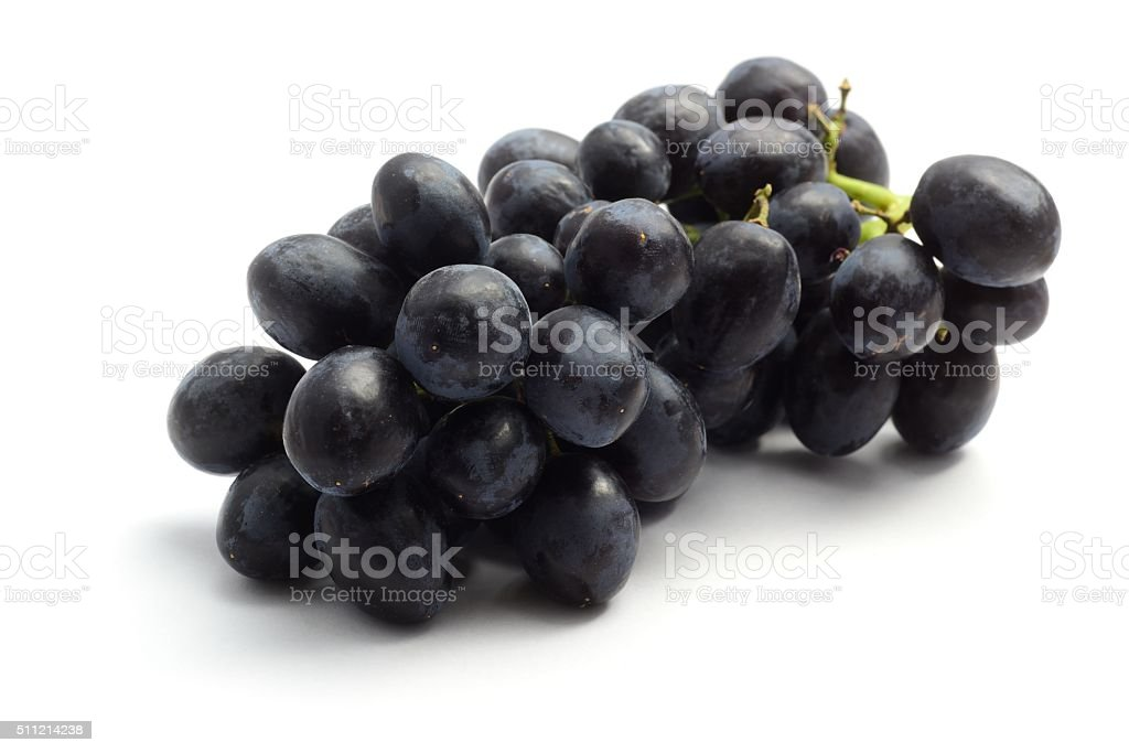 Small bunch of black grapes stock photo