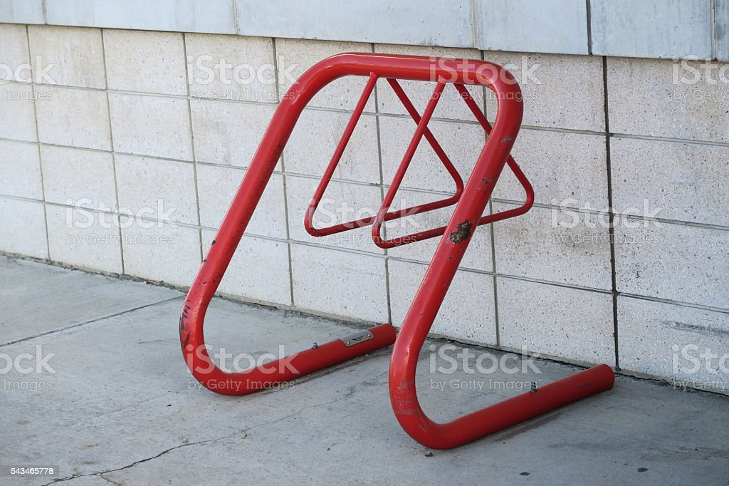 Small business bike rack near entranxce- red metal stock photo