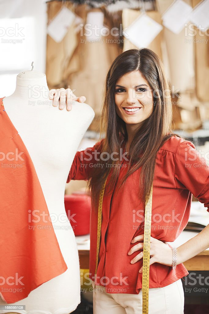 Small business entrepreneur possing next to a manequin. stock photo