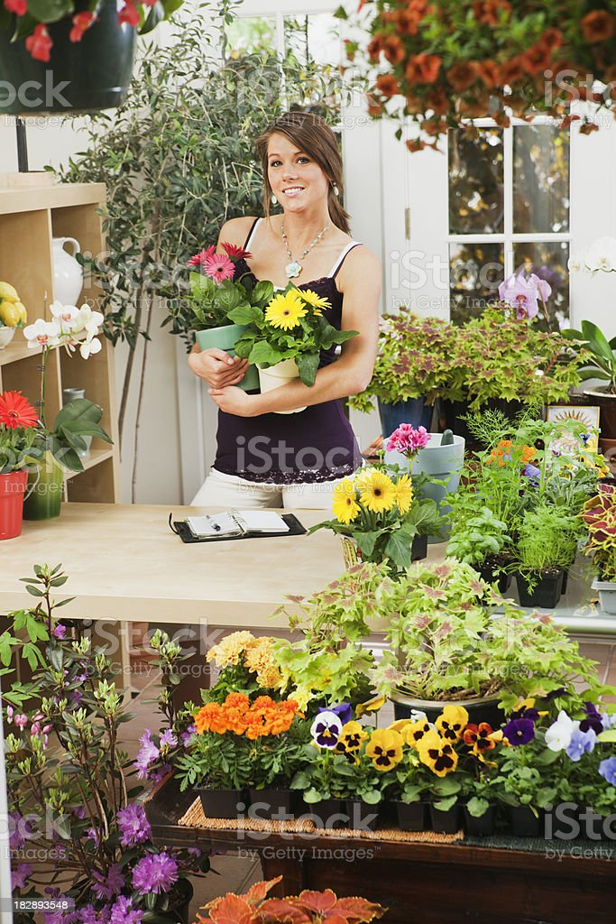 Small Business Flower Shop with Young Woman Florist Owner Vt royalty-free stock photo