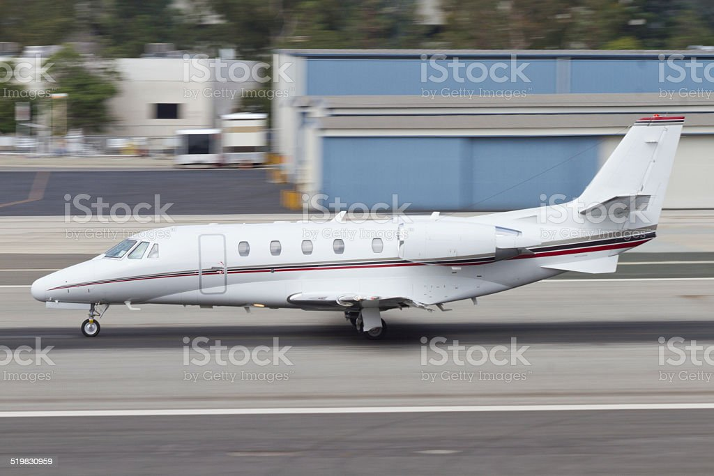 Small Business Jet Departing at Speed stock photo
