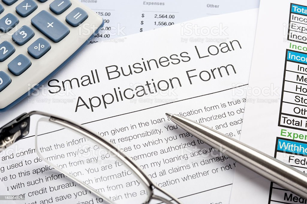 Small Business loan application Form with pen, calculator royalty-free stock photo