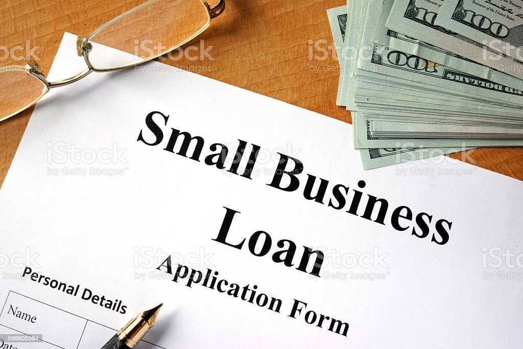 Small business loan form on a wooden table. stock photo