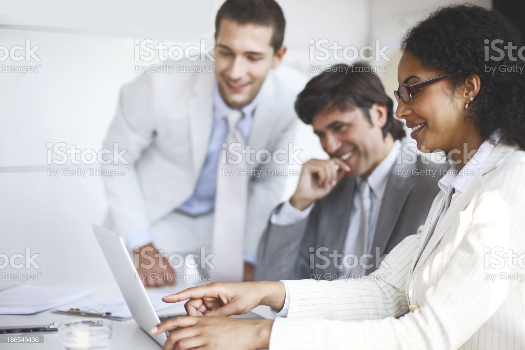 Small business meeting centered around laptop royalty-free stock photo
