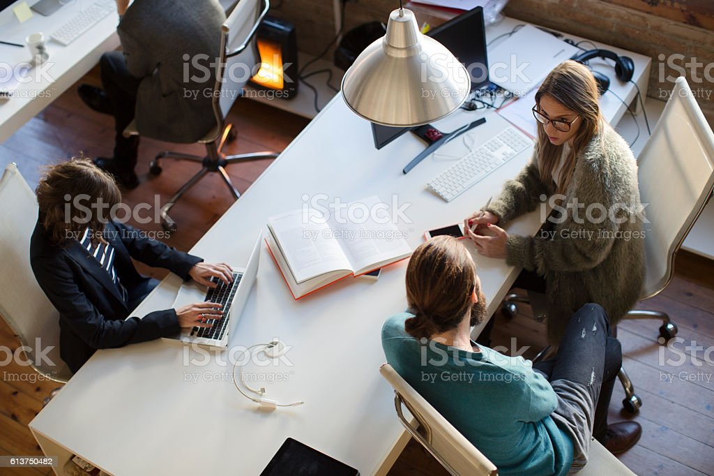Small business meeting in a creative office. stock photo