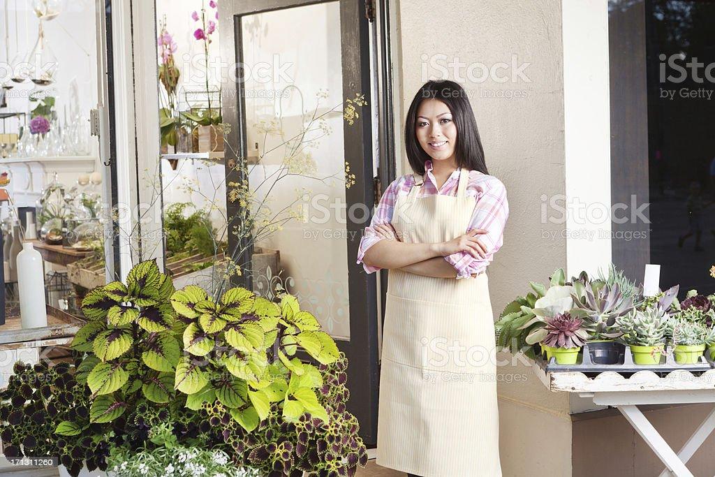 Small Business Owner, Asian Florist Flower Shop Entrepreneur at Store stock photo