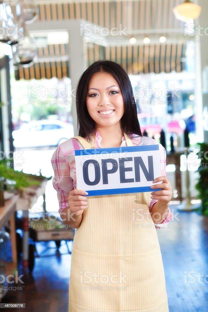 Small Business Owner Florist in Flower Shop with Open Sign stock photo