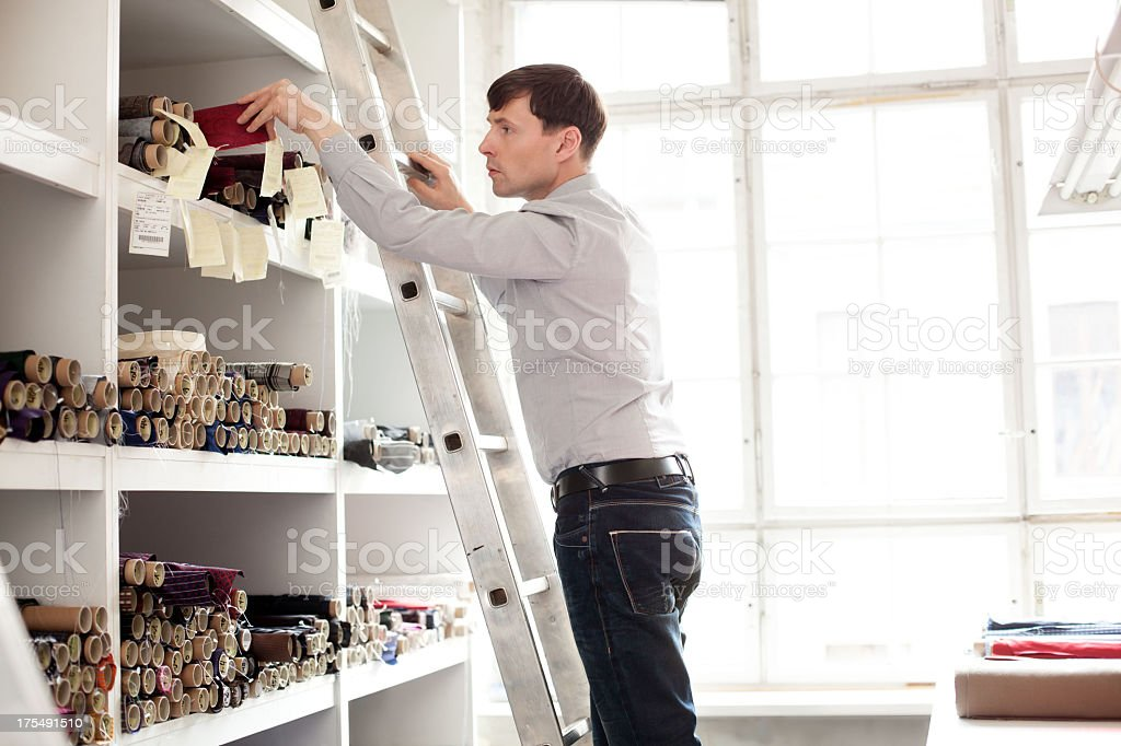 Small business owner grabbing textile stock photo