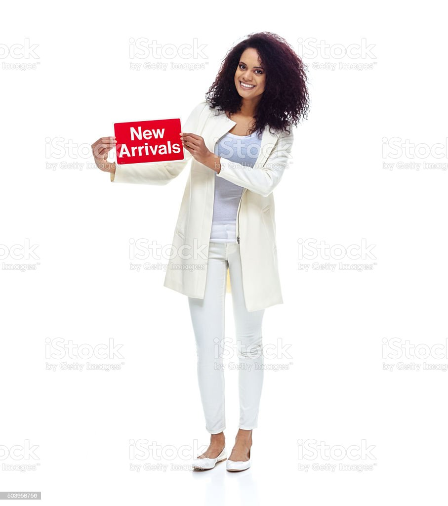 Small business owner holding new arrivals sign stock photo