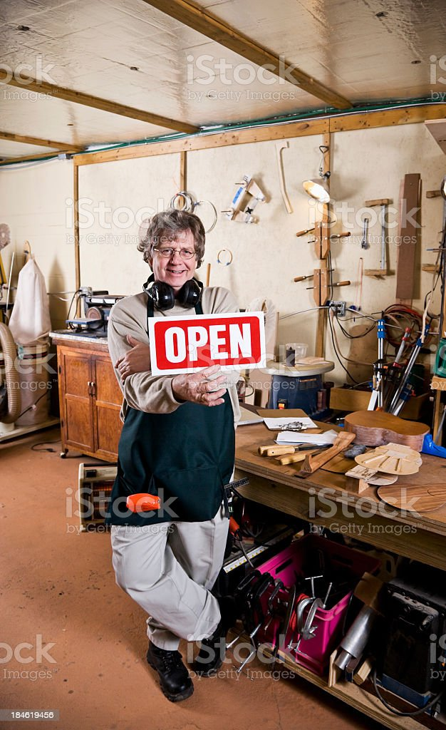 Small business owner, holding open sign stock photo