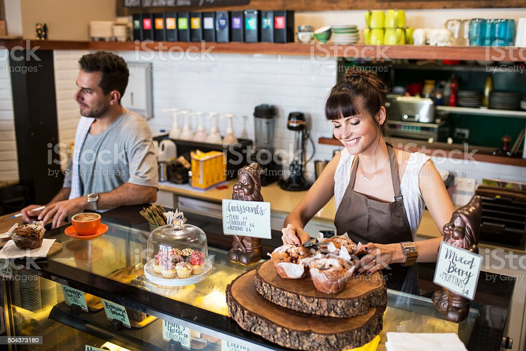 Small business owner in her coffee shop stock photo