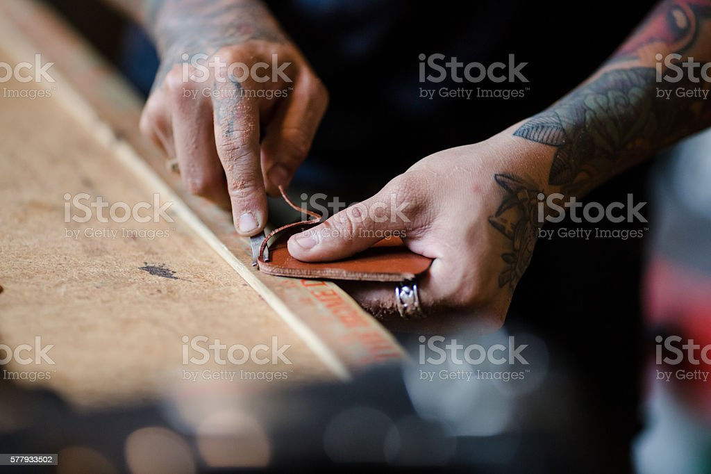 Small Business Owner Making Leather Products in His Shop stock photo