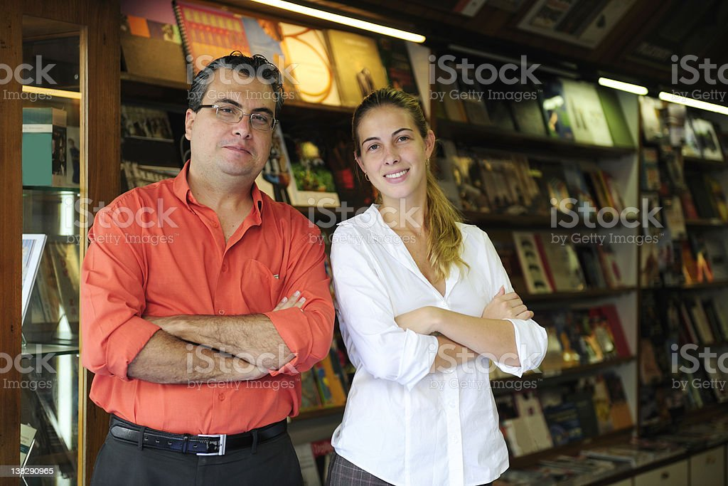 small business: owner of a bookstore stock photo