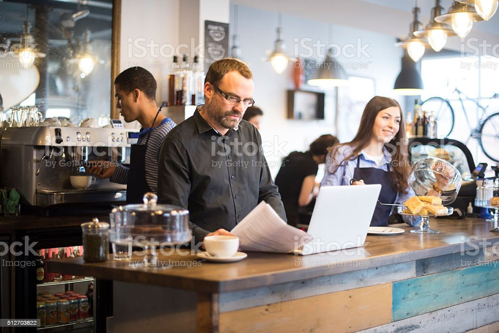 small business owner online banking stock photo