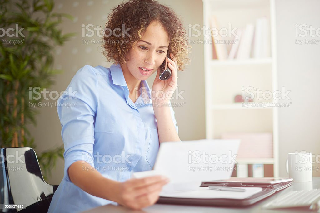 small business owner queries a bill stock photo