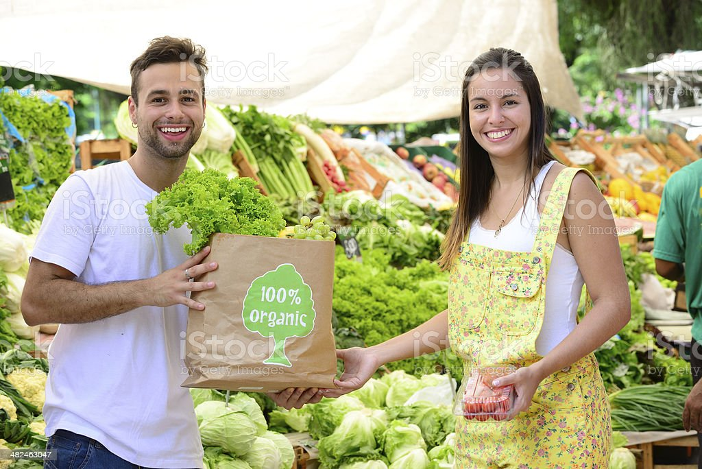Small business owner selling organic fruits and vegetables. stock photo