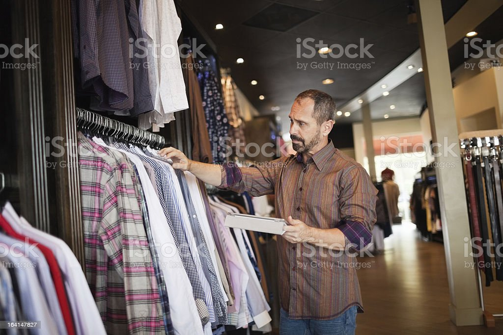Small business owner using digital tablet stock photo