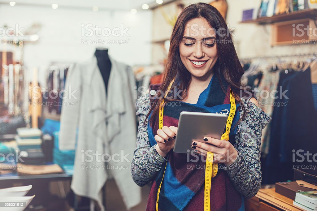 Small business owner with digital tablet stock photo