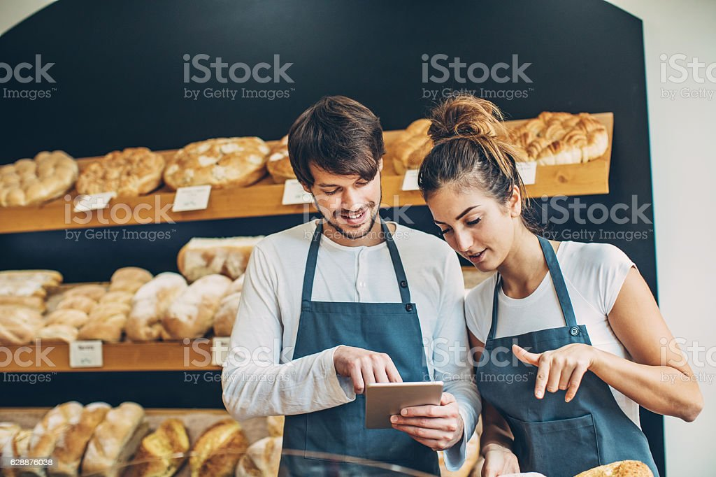 Small business owners checking a digital tablet stock photo