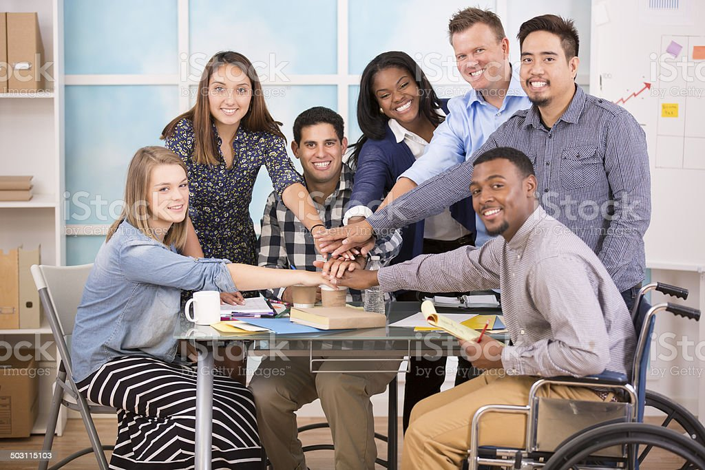 Small business, start up. Creative young adult co-workers collaborate together. stock photo