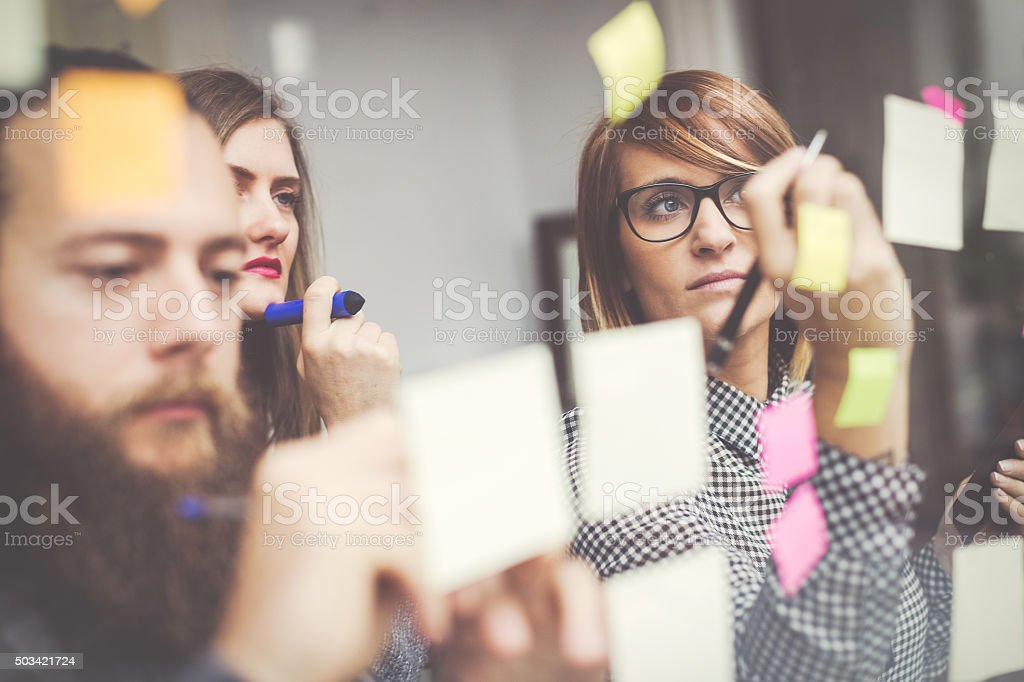 Small business start up team: briefing with notes stock photo