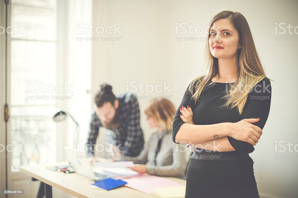 Small business start up team: woman leading stock photo