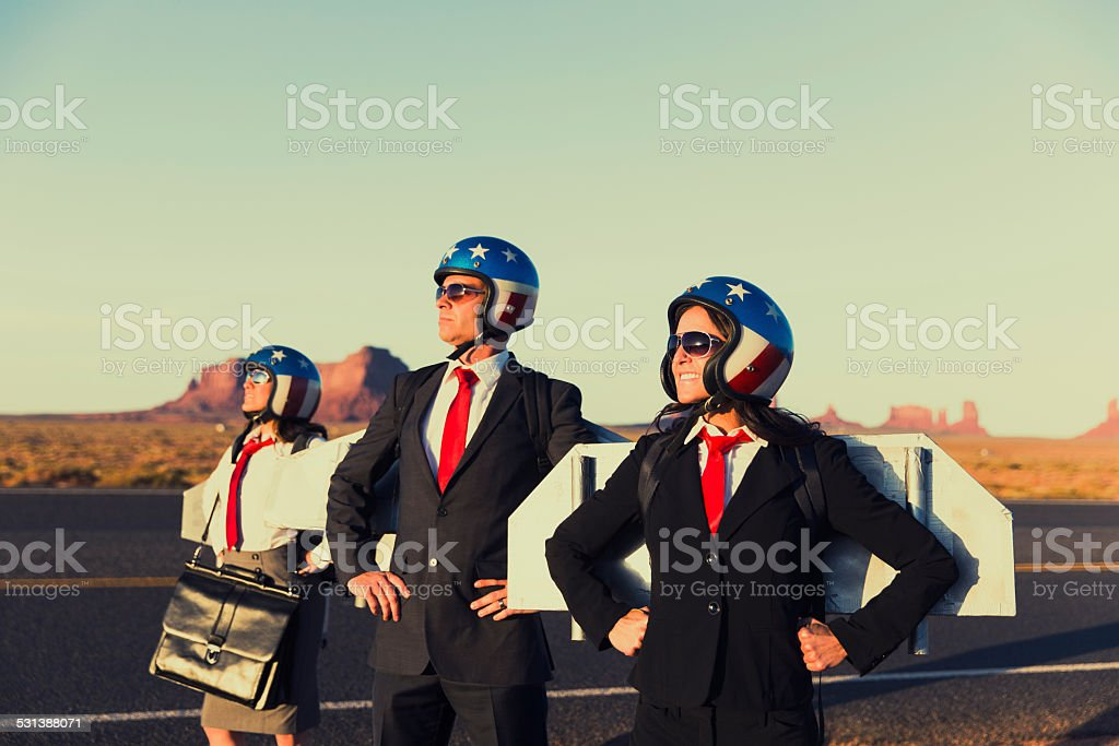 Small Business Team wearing Jetpacks in Monument Valley stock photo