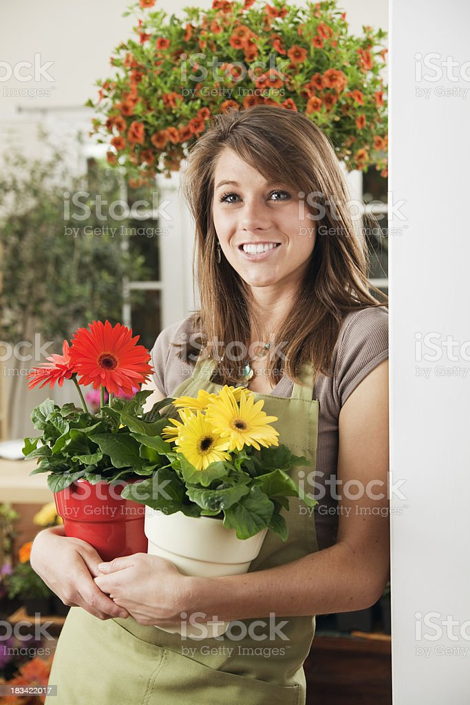 Small Business Woman Florist Holding Daisies in Retail Shop Vt stock photo