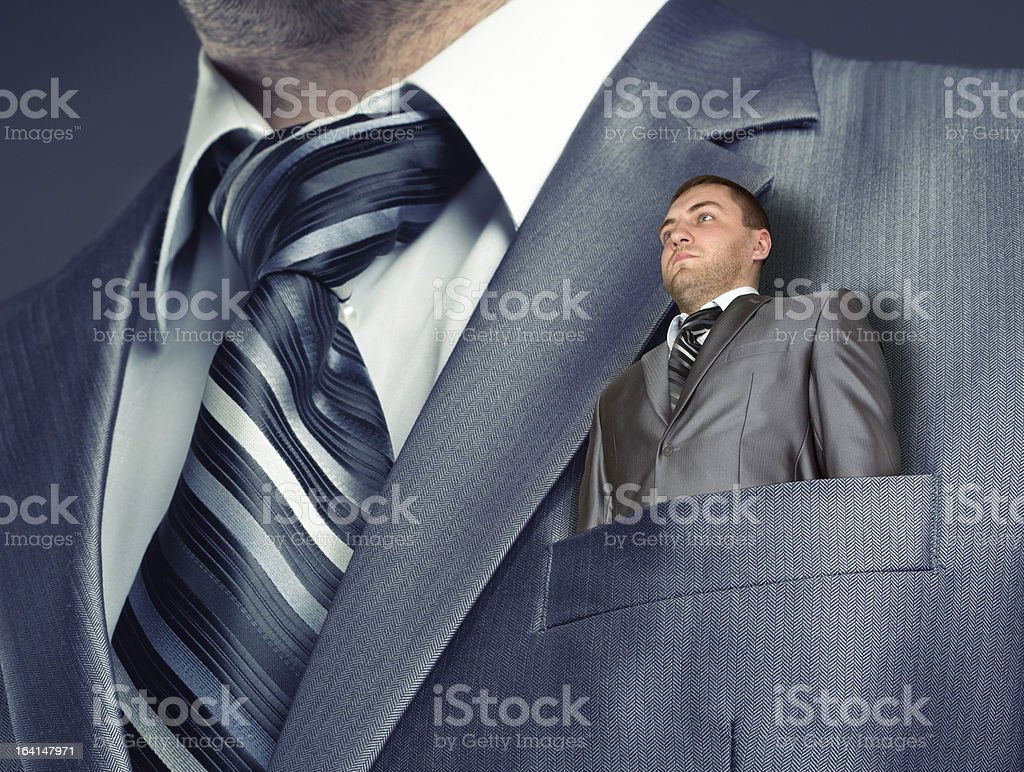 Small businessman in suit pocket royalty-free stock photo