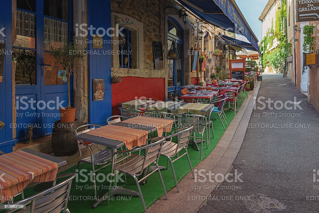 Small cafe on a narrow street in the town stock photo