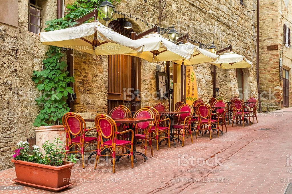 Small cafe on the corner in old city, Italy royalty-free stock photo