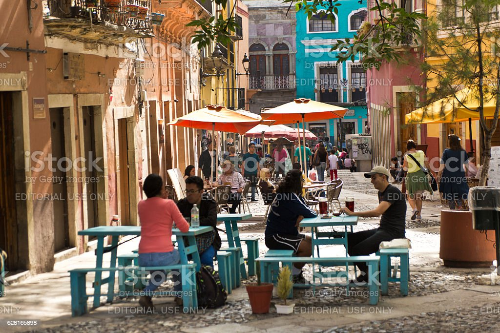 Small Cafe Restaurant with Tourists in Guanajuato, Mexico stock photo