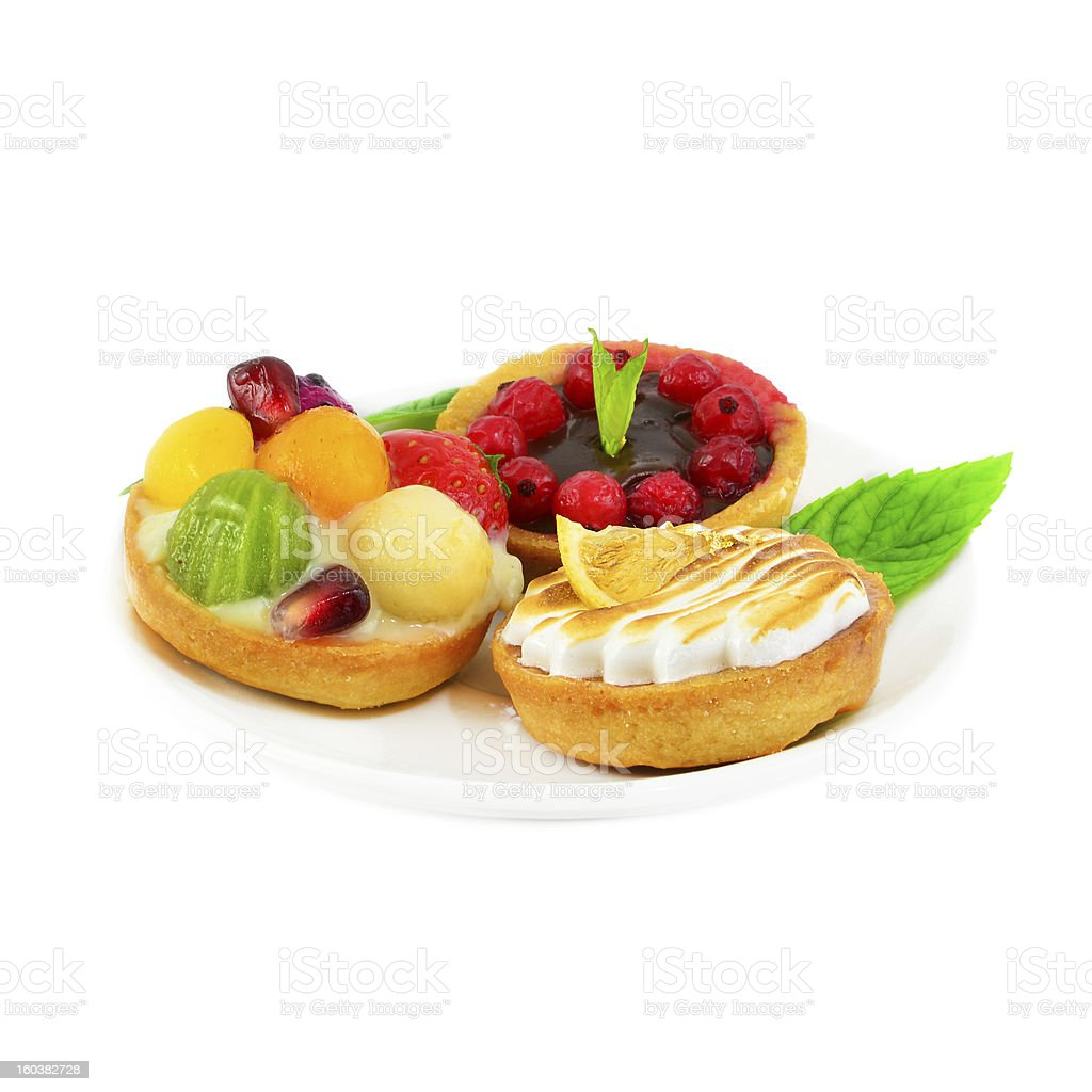 Small cakes with fruit and cream royalty-free stock photo