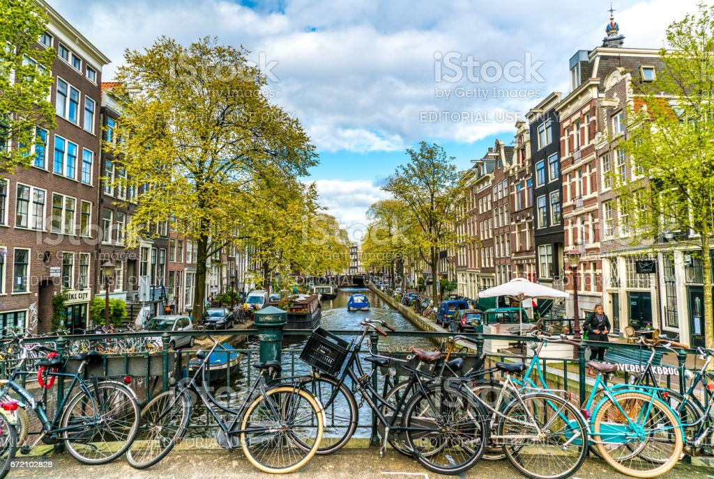 Small Canal in Amsterdam with bikes in front stock photo