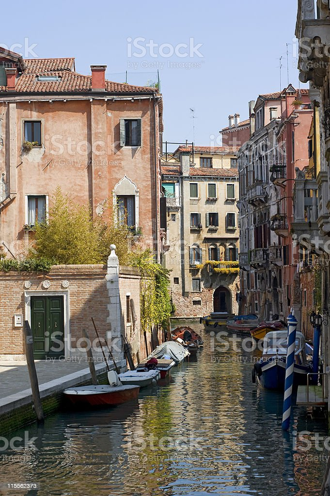 Small canal with boats in Venice, Italy royalty-free stock photo