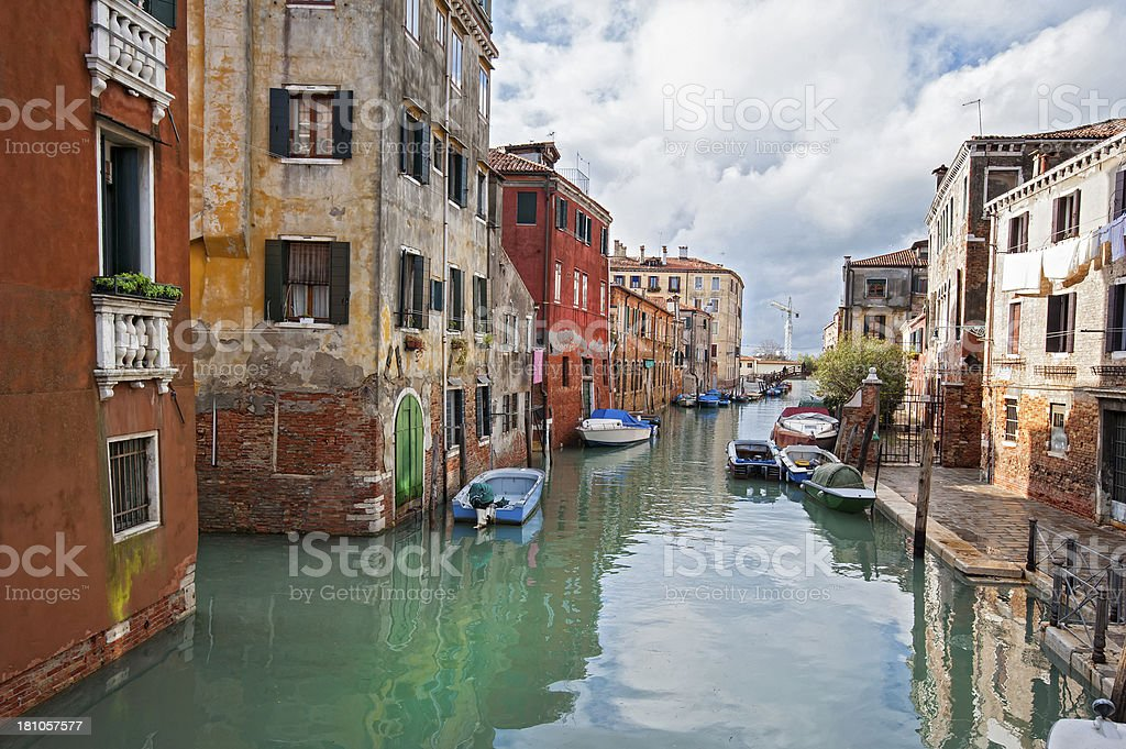 Small canal with bridge and boats in Venice, Italy. royalty-free stock photo