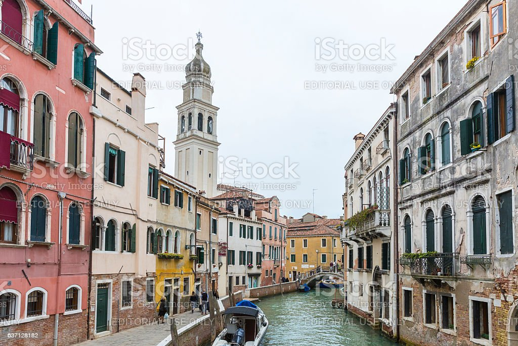 Small canal with Sant'Antonin Church bell tower or campanile stock photo