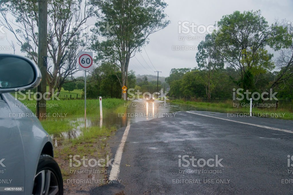 Small Car Crossing Flood Water on Sunshine Coast royalty-free stock photo