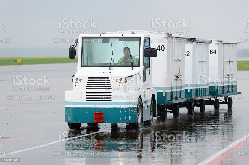 Small car transports luggage containers stock photo