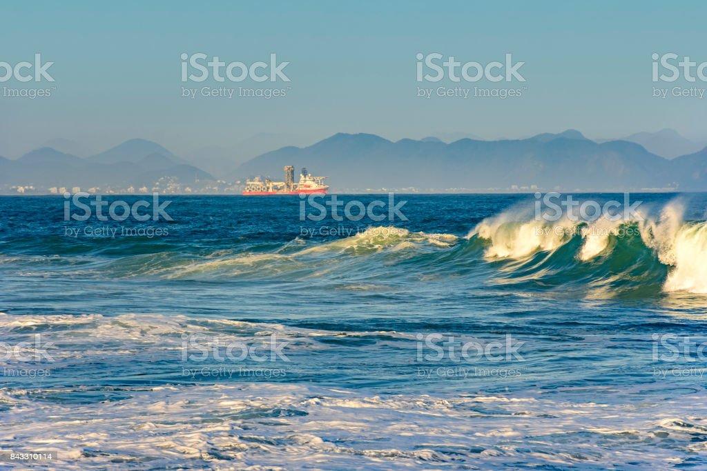 Small cargo ship on the sea stock photo
