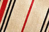 Small carpet of rough textile