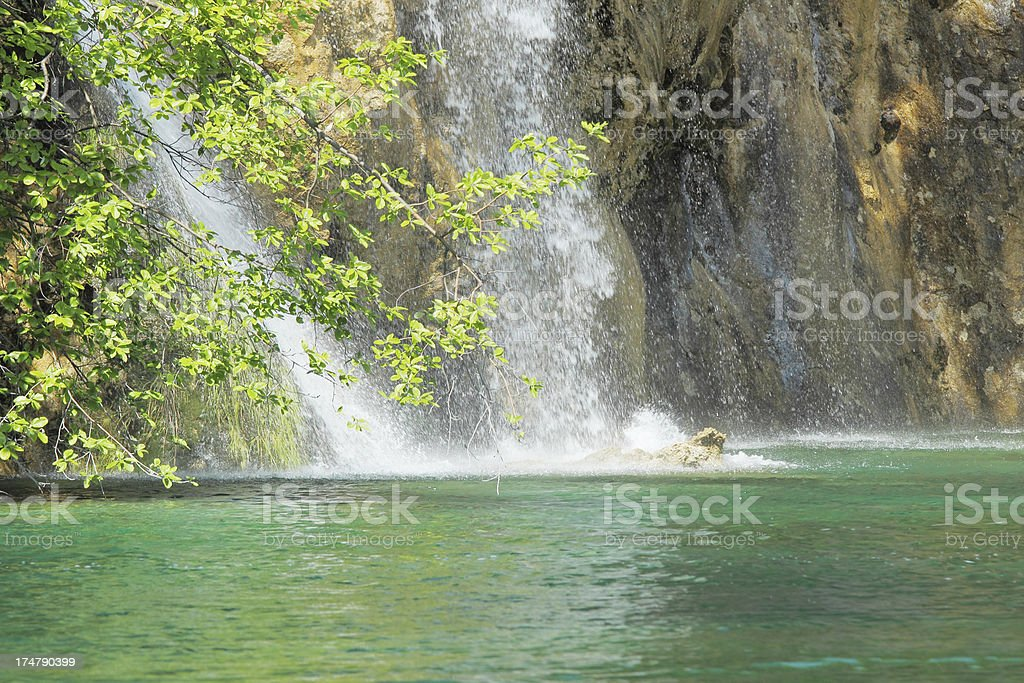 small cascade with streaming waters into turquoise lake  Plitvice Croatia royalty-free stock photo