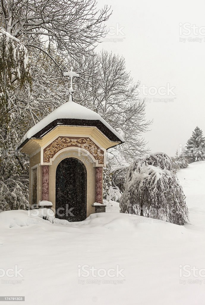 Small chapel covered in snow royalty-free stock photo