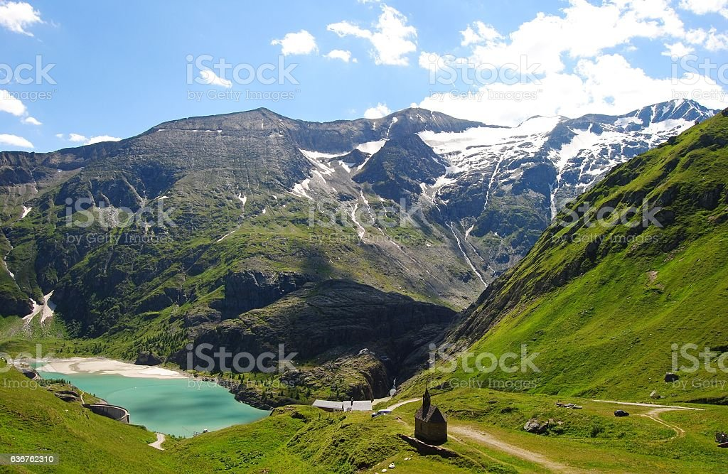 Small chapel in high meadows of Tyrolean Alps. stock photo