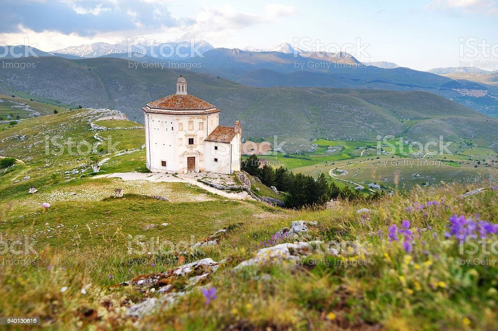 Small chapel near Rocca Calascio castle at summer sunset stock photo
