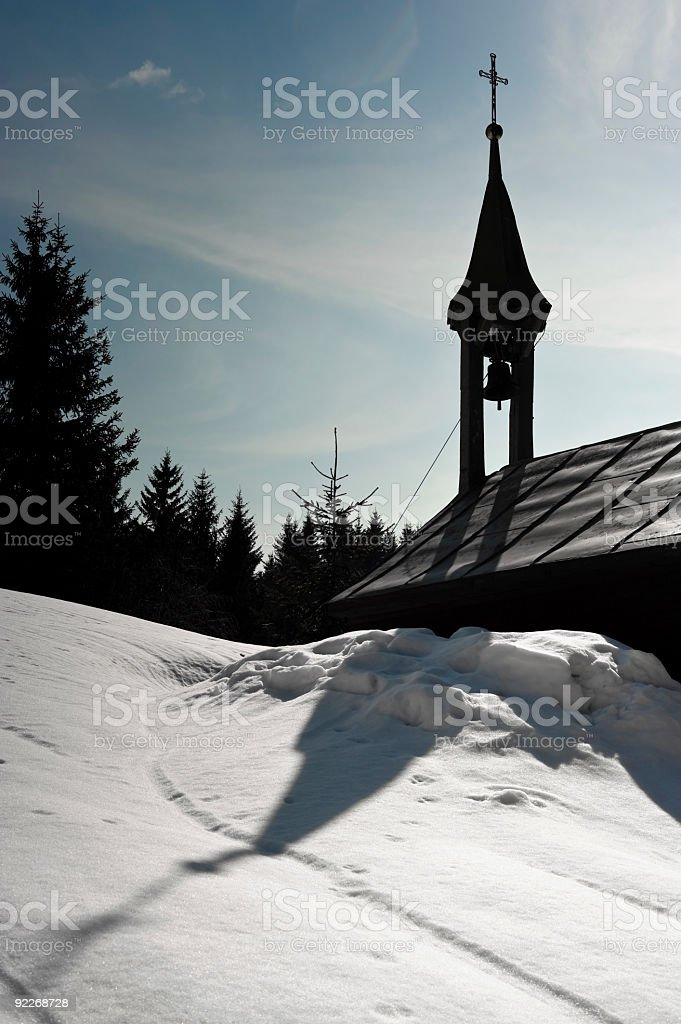 Small chapel silhouette at wintertime stock photo