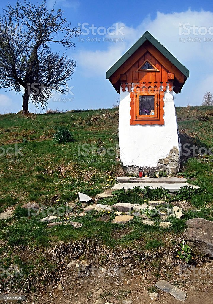 small chapel with isolated tree in Beskid Slaski mountains stock photo