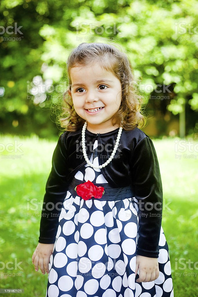 Small Cheerful Indian Baby Girl Outdoor Portrait royalty-free stock photo