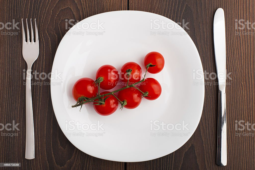 Small cherry tomato on a plate royalty-free stock photo