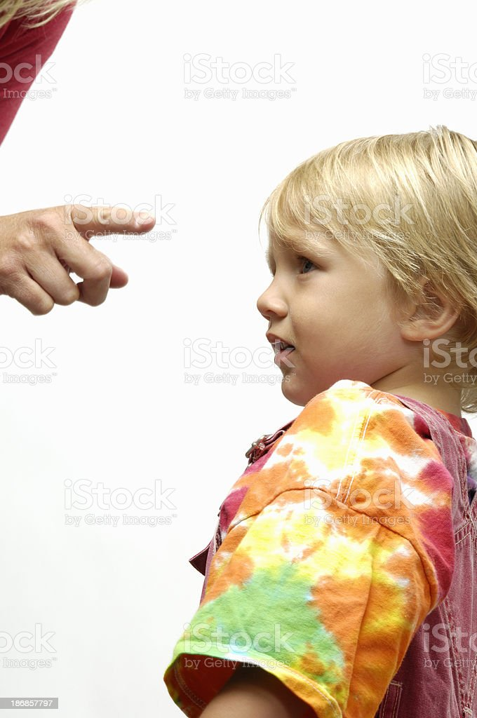 Small child being disciplined stock photo